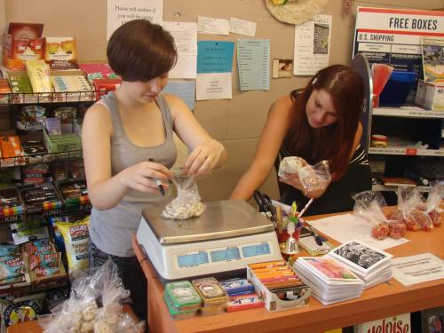 Saguache Works Interns Brianna Long (left) and Kaya Holden (right) weigh bulk snacks for the 4th Street Food Store. Photo: Saguache Works.