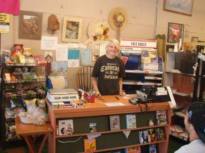 Student Intern Rosey Lowe helps out at the register! Photo: Saguache Works.