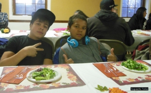Saguache youth Antonio (left) and Luke (right) kept their good table manners in check while eating 'til their heart's content at the Thanksgiving Community Meal in Saguache on November 22. Photo: Saguache Today