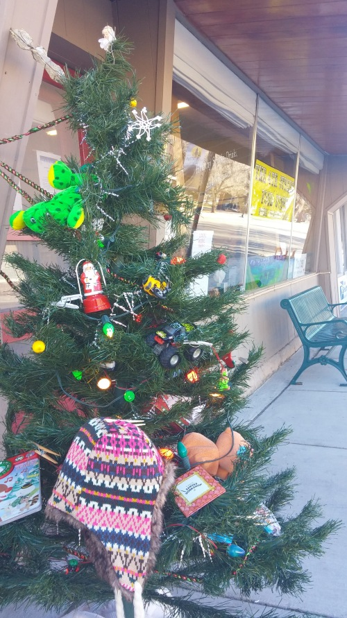"Saguache's ""Giving Tree"" sits outside the 4th Street Food Store in downtown waiting for your present exchange to make the holiday season a bit brighter. Photo: Lynn Nowiskee/Saguache Today."