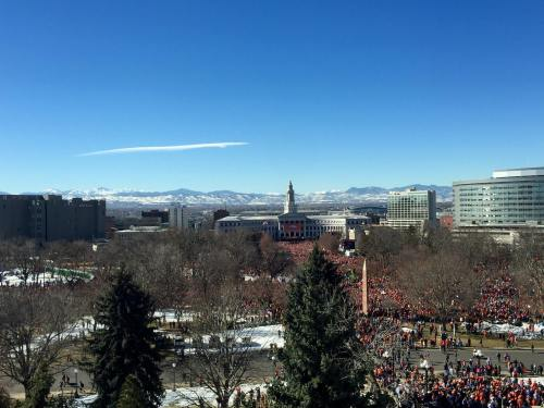 "This photo was takend from State Representative Edward Vigil's office the day of the Denver Broncos rally in Civic Center Park. ""View of Bronco Victory Parade from my office. Beautiful day and beautiful people, got to love this job,"" posted Vigil."