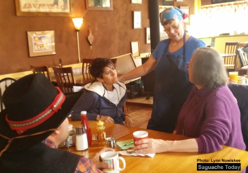 4th Street Diner Owner Ester Mae Last (standing) talks to local patrons about the eatery's current predicament. Photo: Lynn Nowiskee/Saguache Today