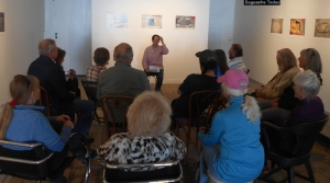 A heraty group of Saguache artists and art-lovers gather for Ariel Goldberg's essay reading.