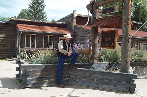 Terry Gillette, Owner/Proprietor of Gillette's Trading Post stands in front of his shop located off Highway 285 in Saguache Today. Photo: Saguache Chamber of Commerce.