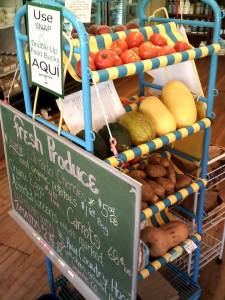 The produce rack at the 4th Street Food Store is stacked with fresh produce - come and get it! Photo: Saguache Works