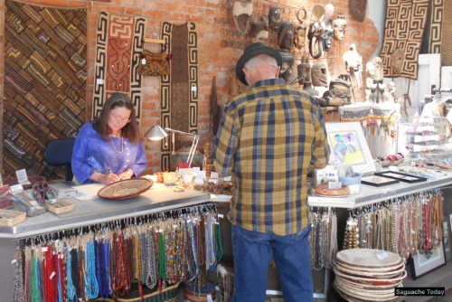 Artist and owner Judith Page writes up the receipt for another satisfied customer at the Magpie Gallery located in downtown Saguache Today.