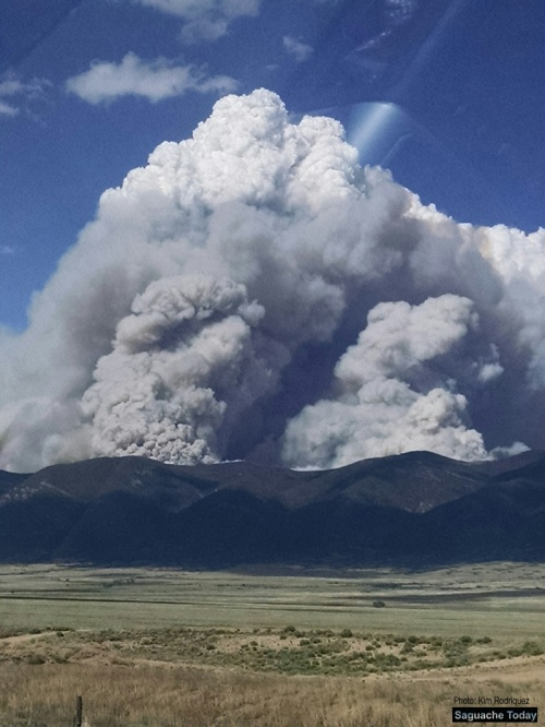 Smoke from a wildfire burning near Hayden Creek in Coaldale (Fremont County) can be seen on the other wide of the Sangre de Cristos in Saguache. Photo: Saguache Today/Kim Rodriquez