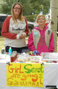 Crystal Gillette-Knight (left) and Saguache Girl Scout Adriana (right) sell home made goodies and gifts to help raise monies for the girls' August trip to Savannah, GA. Photo: Saguache Today