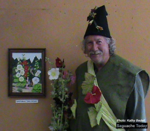 Saguache Mayor and official Hollyhock festival Gnome Greg Terrell welcomes residents and visitors to the annual event