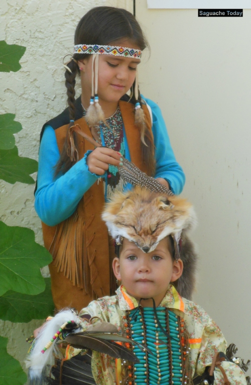 Native American children dress in traditional ceremonial costumes for the Saguache Pow-Wow. Photo: Saguache Today
