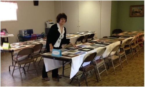 Sarah Fenandez reviews the Saguache Chamber Photo Contest entries on display for viewing and voting at the Methodist Church through August 19.