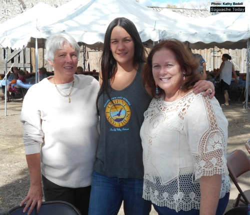 It's smiles all around for Orient Land Trust staff (left to right) Kelley Michelle, Aimee Morfitt and Rosie Rosenberg take a moment to pose at last Saturday's Inaugral Harvest Dinner and Dance. Photo: Saguache Today/ Kathy Bedell.