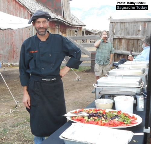 Steven with RustingRam Catering stands next to the Farm-To-Table Harvest Dinner his company prepared last Saturday at the historic Everson Ranch. Photo: Saguache Today/Kathy Bedell