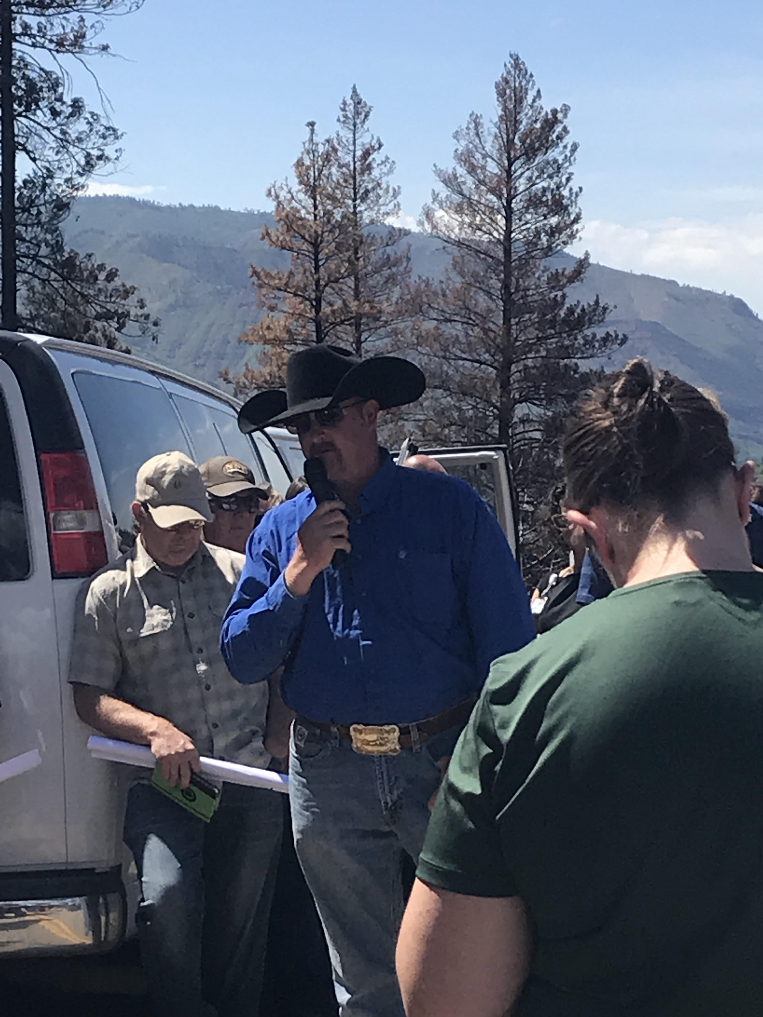 Jonathan Patcheck, a brand inspector from Southwest Colorado speaks during the drought tour about the impacts of the drought and the 416 fire on his ranch